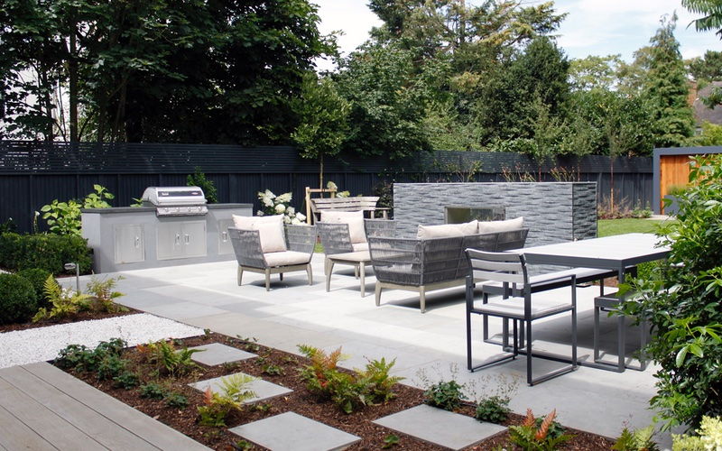 Grey Yorkstone and Millboard installed by Landscaping Solutions.